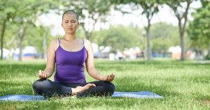 Practicing yoga for stress reduction during breast cancer radiation therapy
